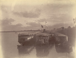 A steamer of the Irrawaddy Flotilla Company with flats alongside, shewing the way troops were conveyed up the river